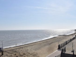 Clacton's beach completely empty, along with the seafront and pier looking completely deserted